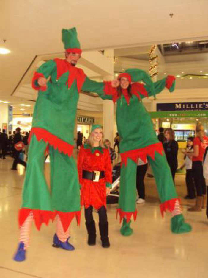 Giant Elf Stilt Walkers